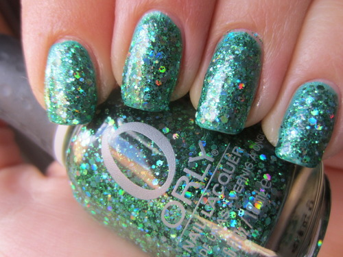 "orly ""mermaid tail"" new from the orly flash glam fx collection! i have like 8 of these polishes on my wish list and this one was the first i found! its a green chunky glitter with chunky pieces of holographic green glitter and green microglitter.  this is just 1 coat over zoya ""zuza"" which is a teal color.  so look how freaking opaque mermaid tail is!"