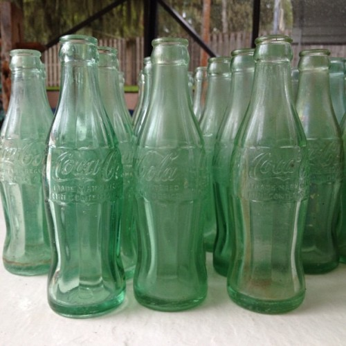 Cleaned up some old coke bottles today. Date back to the 1920's. Not too bad since most of these were found in the river. (Taken with Instagram)