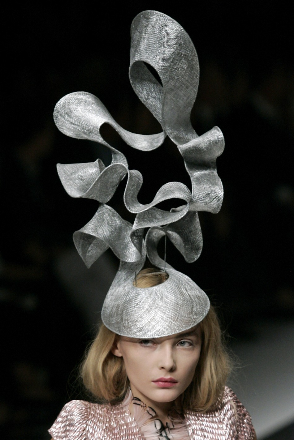 Snejana Onopka displaying a hat created by Philip Tracy for the Alexander McQueen S/S 2008 collection.