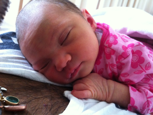 Baby Evelyn at 6 days old. Loves: breast milk, sleeping, clean nappies and punking dad with surprise wee's whilst being momentarily nappy'less. Hates: baths, loud noises and woolen beanies.