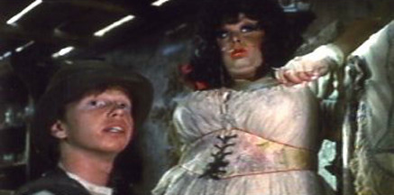 Courtney Gains (as Red Dick Barker) and Divine (as Rosie Velez) from Lust In The Dust, 1985