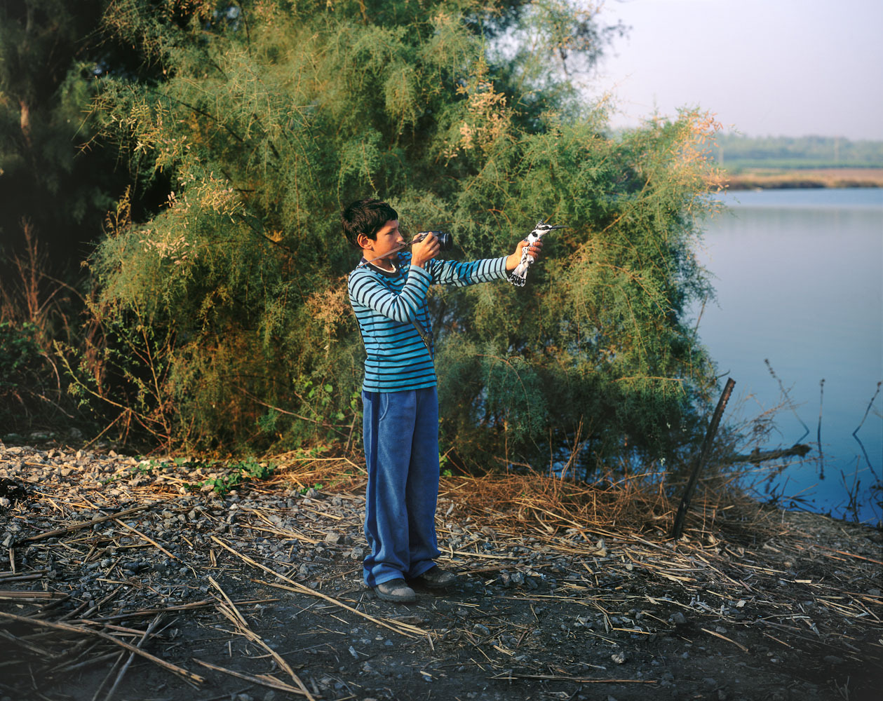 Zohar With Pied Kingfisher, 2010 Photographer Yaakov Israel set out to document the people and landscapes of the country that shares his name. His new book tells a story of daily life in a land with a deep history and uncertain future. See more photos here.