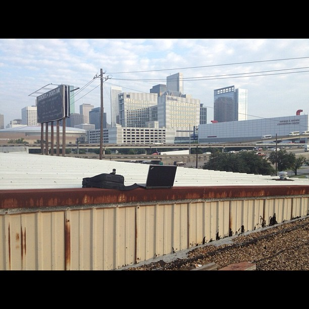 Workin' on the roof.  Such a bad ass view of the Houston skyline, Toyota Center, and the Convention center (Taken with Instagram)