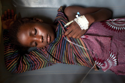 "Cholera Epidemic Escalates Along Sierra Leone and Guinea Border  The onset of the rainy season in West Africa has caused an increase in cholera cases on both sides of the border between Sierra Leone and Guinea. More than 13,000 people have been admitted to hospitals in the capital cities of Freetown and Conakry since February, when the disease was declared an epidemic. Doctors Without Borders/Médecins Sans Frontières (MSF) currently has more than 800 beds available to treat cholera patients and is opening additional cholera treatment centers and rehydration points in collaboration with local authorities.  Cholera, which spreads through contaminated water and flourishes in unsanitary conditions, causes days of diarrhea, vomiting, and stomach cramps, and leaves patients visibly emaciated after. It is a punishing affliction. ""I want to die,"" whispers a patient in MSF's treatment center in the Mabella slum in Freetown, Sierra Leone. ""I'm tired, tired of this disease.""Photo: A 10-year-old patient recovers from cholera at Donka Cholera Treatment Center in Conakry, Guinea.  Guinea 2012 © Holly Pickett/MSF"