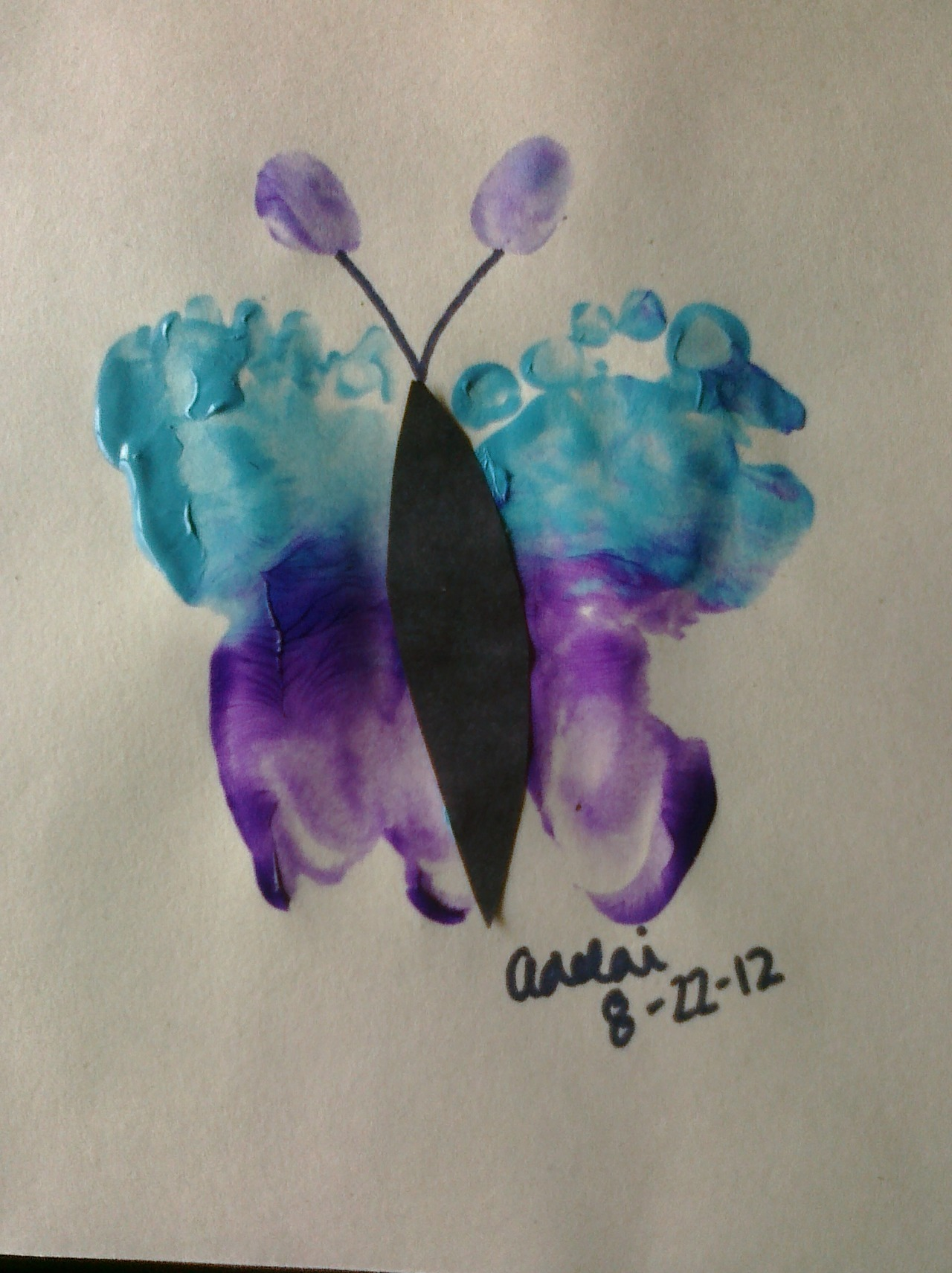 We made a footprint butterfly today!