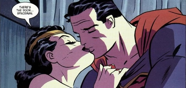 Yes, there was a kiss in the comics. The New Frontier by Darwin Cooke.