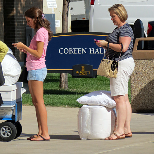 Mobile phone break while waiting to move into Cobeen Hall at Marquette University.