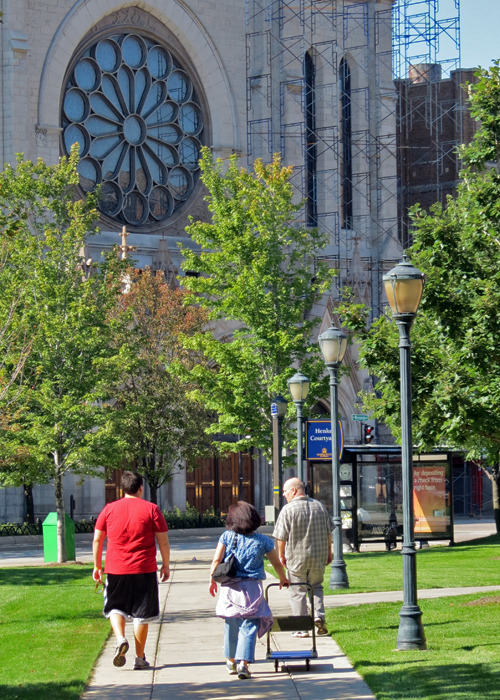 A Marquette family walks through the Henke Courtyard near Gesu Church.
