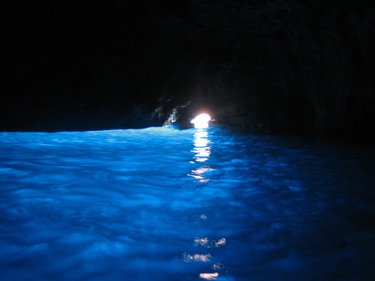 the-pursuit-of-hapa-ness:  The Grotta Azzurra (Blue Grotto) in Capri, 2011. Sunlight seeps in through an opening below the water's surface, setting the cavern alight in a brilliant blue.   SOOO PRETTY!