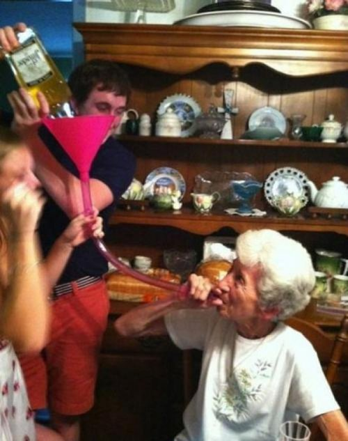 Old Lady Drinks Liquor from Beer Bong Did you have a fun time at Grandma's house?