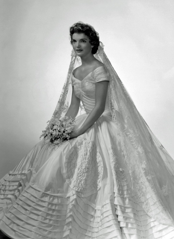 theniftyfifties:  Jacqueline Kennedy in her wedding dress, 1953.
