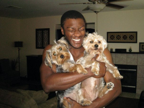 Aldis Hodge, star of TNT's Leverage, with two dogs.
