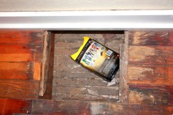 Secret compartment in the floor of old church was used to house each week's offerings.
