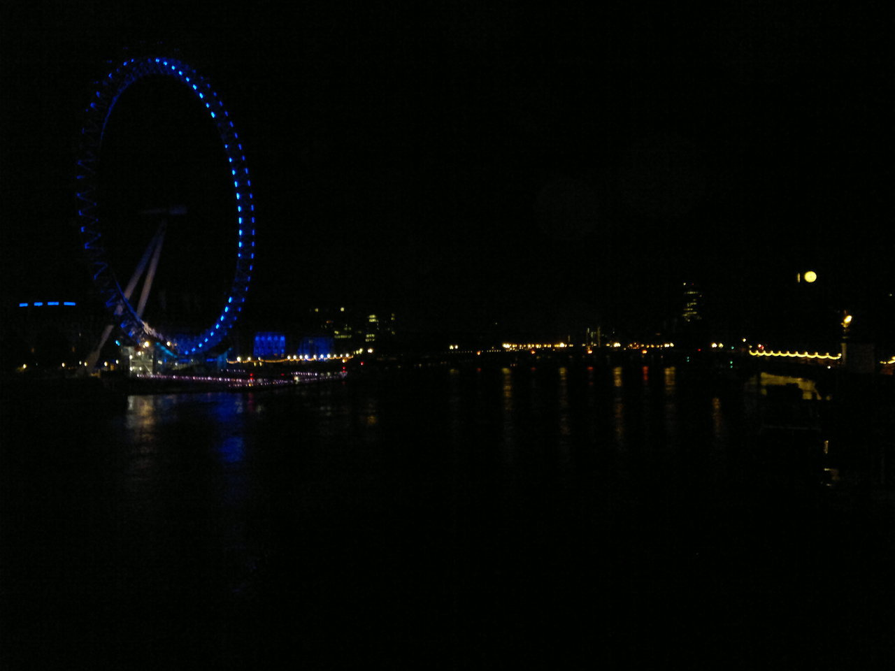 London Sleeping Took a walk around London last night at about 2.30am, was amazing to see the city in the dead of night, with almost nobody else around. Took this from the Golden Jubilee footbridge, the London Eye to the left of the picture and the clock face of Big Ben to the right. At about 4am the city started to come alive again, the first few people on their way to work walking along the Embankment, the deliveries to the shops at the train stations, and a gradual increase in the amount of traffic on the roads. Arrived at Waterloo to go home a few hours before the station opened, and so had to spend the few hours in between in the St Thomas' Hospital cafe, which seemed to be the only place that just continued on as normal throughout the night. Caught the train back to Putney at 5.30am, in time to see the deliveries of the day's papers to the station, and the first few commuters from that station. Definitely going to do this again soon, and get some more photos of the city at night.