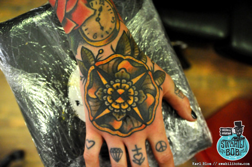 Old school traditional flower hand tattoo by Karl Blom