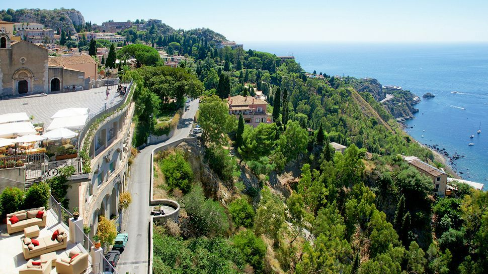 Hotel Metropole is set on the cliff overlooking Taormina bay