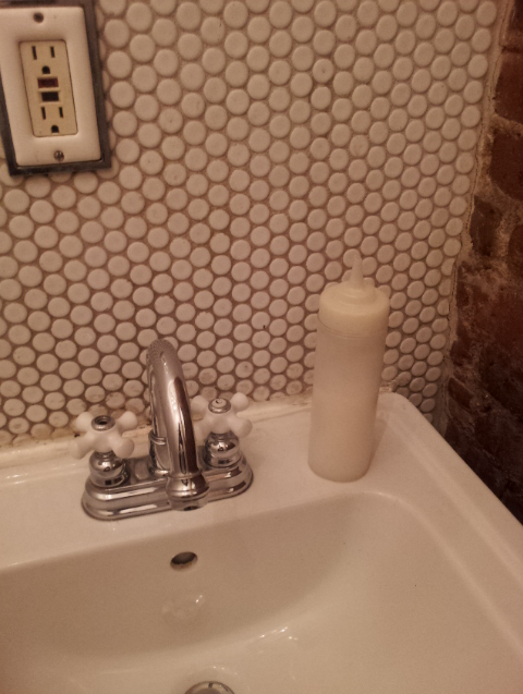 That is a condiment container in the bathroom of this little cafe in Brooklyn by the name of Outpost.  What's in it?  Handsoap. In theory, I guess this is a cute idea, but in actual practice….No.  I've seen some of the people coming out of the bathroom at Outpost and I'm not trynna think about them pooping, wiping, and then picking up the bottle of handsoap!  I get squicked out enough just pushing a little pump handle in the bathroom, but I have to wrap my whole hand around this possibly doo-doo infested bottle just to get some soap!?  Yeah, I know I'm about to wash my hands right after, but I don't need those 3 seconds of somebody else's poop hand germs in my palm. Brooklyn be makin no kinds of sense sometimes.