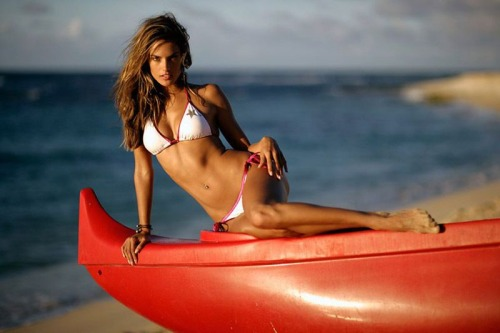Alessandra Ambrosio on a boat, in a bikini, at the beach. I want to know what you're thinking. (fabulous photo via FB REvolution Gallery)