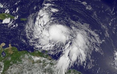 "What happens if Tropical Storm Isaac hits the GOP convention? — As of early Thursday, Isaac was churning in the Caribbean, 250 miles southeast of Puerto Rico. It's moving slowly toward the Dominican Republic and Haiti, then Cuba, and could reach the Florida Keys early Monday, the opening day of the convention, and the start of a week of parties and speeches leading up to the official nomination of Mitt Romney as the GOP's presidential candidate. The storm could reach Tampa by that night or the next morning. There's a remote chance Isaac could veer west into the Gulf of Mexico, gather strength over its warm waters, then curve back to hit just north of Tampa as a major storm, says meteorologist Alex Sosnowski of Accuweather. If Isaac were to hit as a Category 4 storm, with winds of 130 mph to 156 mph, it could send 20 feet of water over the convention site, says Masters of Weather Underground. Even if it hits as a weaker Category 2, with 96- to 110-mph winds, the area would have to be evacuated. The bottom line, says Tampa Mayor Bob Buckhorn, is that if things get dangerous, ""we're prepared to call it off. I mean, human safety and human life trumps politics. I think the RNC recognizes that."" More… Photo: Joe Raedle/Getty Images"