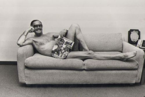 "seanhowe:  STAN LEE, CENTERFOLD (photograph by Eliot R. Brown) When Stan Lee visited New York in January 1983, the editorial staff was at the peak of its yuk-yuk, hand-buzzer giddiness. They'd been shooting photos of each other in superhero costumes for some of the covers—several staff members appeared on the cover of the last issue of SPIDER-WOMAN—and now they were putting together a comic that consisted wholly of photos of intra-office hijinks. They wanted to include Stan the Man. Lee, the original ringmaster, jumped at the chance to pose for a nude centerfold. Marvel staffers photographed Lee with an oversize comic book covering his private parts; soon after, they received a call from his assistant in L.A. ""Stan is wild,"" said the assistant. ""He should not have been naked for your centerfold. Please. Don't."" (A Hulk costume was later superimposed over Lee's body in postproduction.) Text from Marvel Comics: The Untold StoryUPDATE: Photographer Eliot R. Brown adds, ""Stan indeed kept his fire-engine-red bikini briefs on—very business-like, I must add. You'd have thought he did this every day."""