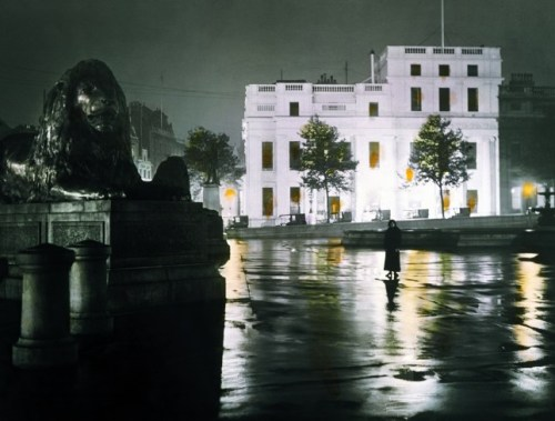 1910. A wet night in Trafalgar Square. A woman poses for a moody night-time shot. Despite the rain, a row of taxis wait on the west side of the square - Anonymous A new photo book by Taschen captures images of London from the Victorian era to the swinging '60s and the present day.  London: Portrait of a City book website Time Website sample of the pictures