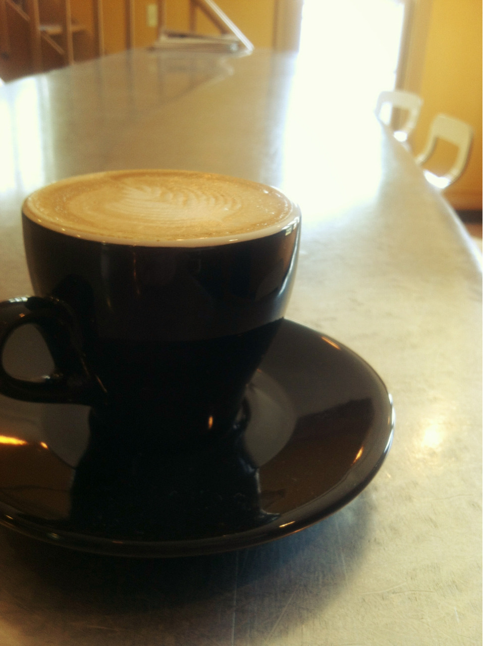 "Traditional capp at @oneline's ""Wiggin Street Coffee."" Thanks to Dave for the pretty pour. Beautiful space."