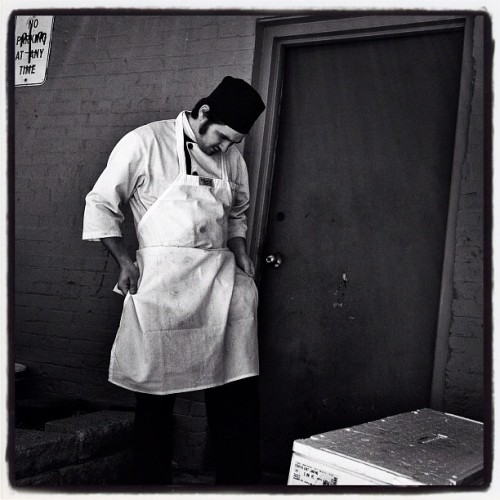 Sushi chef #iphone #procamera #snapseed #noir #sushi #chef #streetphotography  (Taken with Instagram at Sushi Ya)