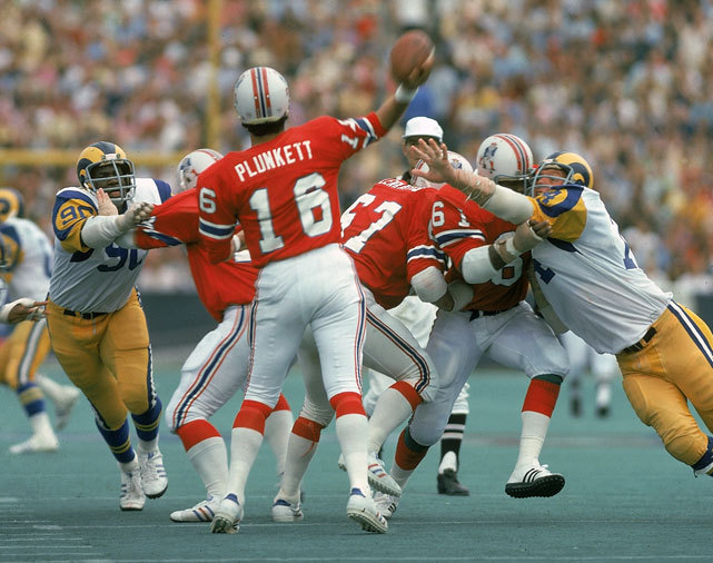 Patriots quarterback Jim Plunkett looks for an open receiver during a 1974 game against the Rams at Foxboro Stadium. SI's Don Banks has made his AFC East predictions and New England, who has finished first nine of the past 11 years, is in position to make another Super Bowl run. (Neil Leifer/SI) BANKS: Patriots favored to win AFC East yet again | Notes on all 32 NFL teams