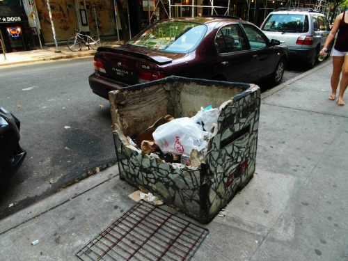"The ""Eat Me"" flower box on St. Mark's Place doesn't look so good (via EV Grieve, Photo by Bobby Williams) So, some jackoff destroyed the Crif Dogs NYC ""Eat Me"" mosaic planter on St. Mark's Place.  Fuck that guy. One more thing to add to the pile. If you're inclined, please DONATE to help fix the planter here: http://mosaicmannyc.com/donate Thanks in advance. ——————————— Like Jim on Facebook or Follow him on Pinterest and Twitter @MosaicManNYC Check out The Official Mosaic Man Collection on Etsy and CafePress for belt buckles, t-shirts and a variety of other items featuring Jim's designs. Proceeds go toward supporting Jim's work on The Mosaic Trail. Or you can make a fully tax-deductible donation here."