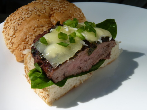 Hamburger with manchego cheese. Local ingredients: spinach, pesto, green onions, and goat cheese.