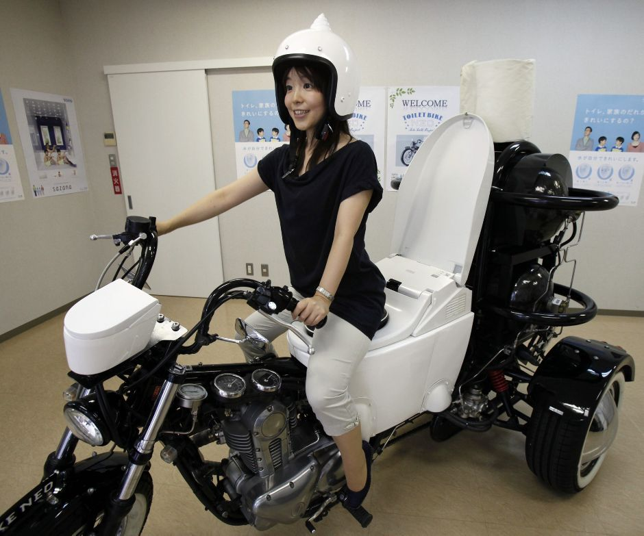 "'Toilet Bike Neo' goes where no john has gone beforeJapanese toilet maker TOTO rolled out a ""Toilet Bike Neo"" to raise awareness about bathroom emissions and water savings. The eco-friendly three-wheel 250cc motorcycle with a specially customized toilet-shaped seat runs on bio-fuel from the discharge of livestock or waste water. (AP Photo/Koji Sasahara)"
