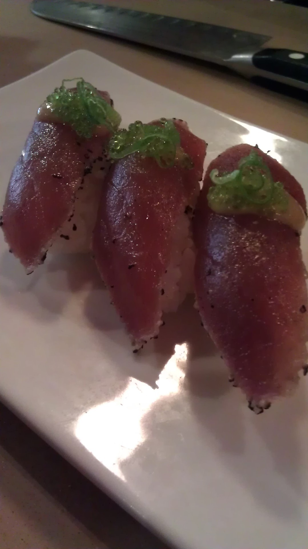 Try our new Tuna Tataki. It's seared tuna with a little bit of salted black pepper, topped with some miso sauce and scallions. Yummy!