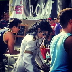 Spotted #MichaelJackson buying drink tickets at a festival smh that fool ain't dead