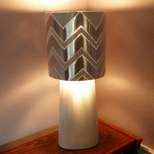 DIY Hardware Store Tin Punched Lampshade Tutorial from Dream a Little Bigger here. This uses tin flashing you can get at any hardware store. This reminds me of the DIY City Skyline Pierced Lampshade Video Tutorial I posted from Thread Banger here.