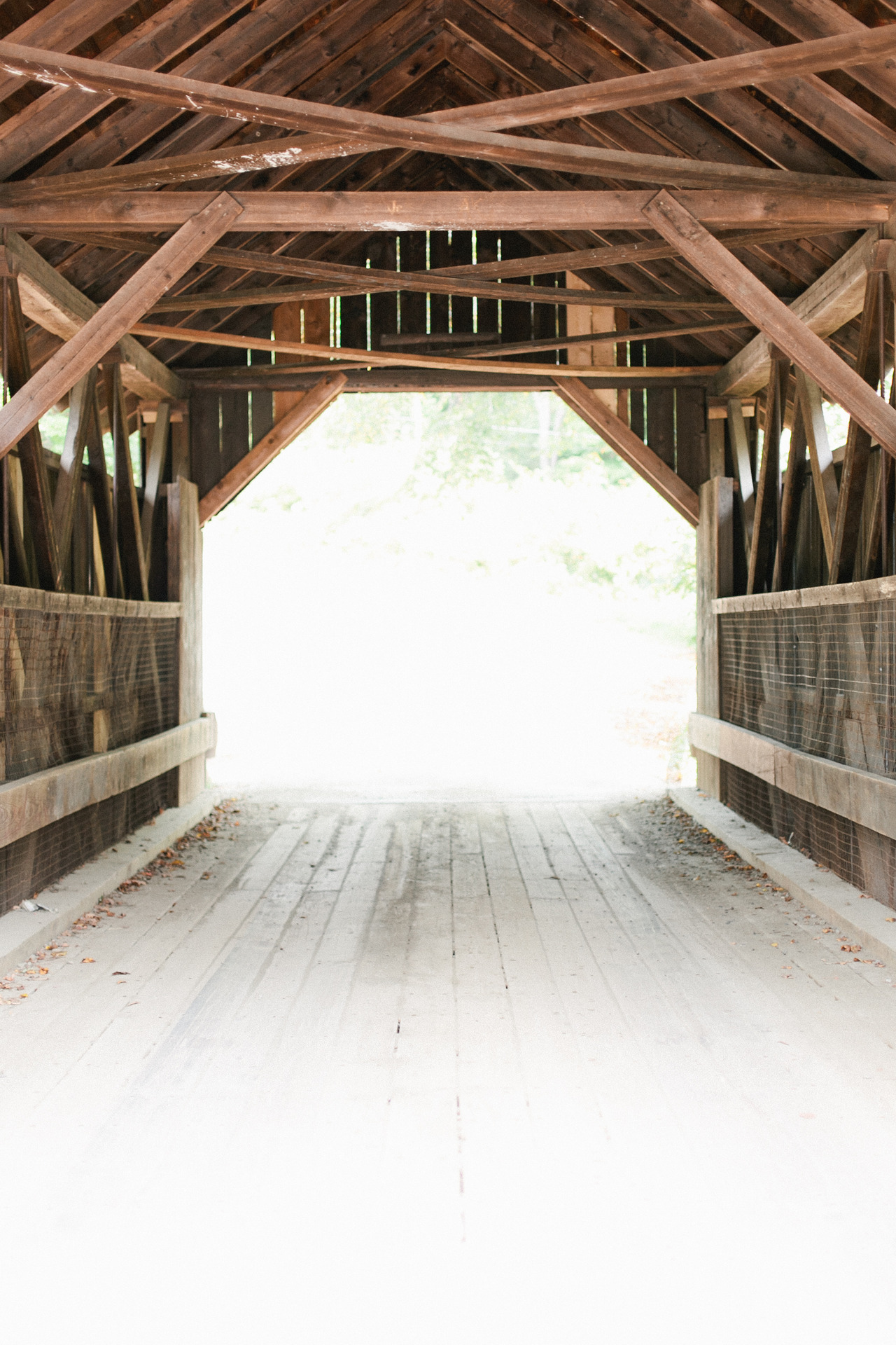 Last week I photographed a portrait session on a covered bridge in Vermont thought to be haunted (Emily's Bridge), and now as I go through the photos I have myself a little spooked.  I just know I'm going to see a ghost in the shadows.  And also I wish I had Photoshop so I could somehow add a ghost to the shots and completely freak these people out when they look through their proofs.
