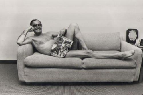 Yes, its a picture of Stan Lee wearing only a comic book. No, I do not know WTF.