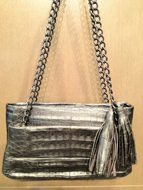 Nancy Gonzalez metallic crocodile bag with huge tassels.  The chain is covered in exotic skins as well.