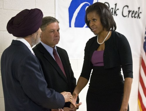 First lady Michelle Obama greets Sikh temple secretary of the board of trustees Kulwant Singh Dhaliwal, left, and Oak Creek, Wis. Mayor Stephen Scaffidi, before talking to victims of the August 5th shooting in Oak Creek, Wis.