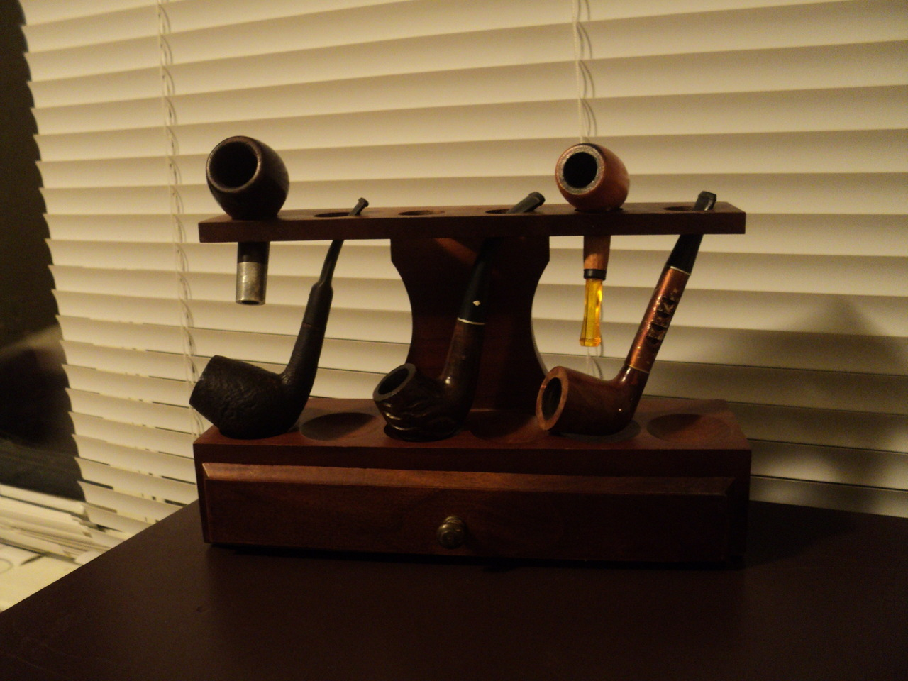 "sharpbriar:  My new pipe collection.  Got a great deal on some estate pipes and a stand. The bowl on the left is a Kaywoodie Ninety Fiver that the ""drinkless"" stem broke on.  Not real sure what to do with it now. From left to right: Kaywoodie mentioned, Bjarne Rustic handmade in Denmark, Dr. Gabow Duke, Little Cherry Thang, Medico Ventilator."
