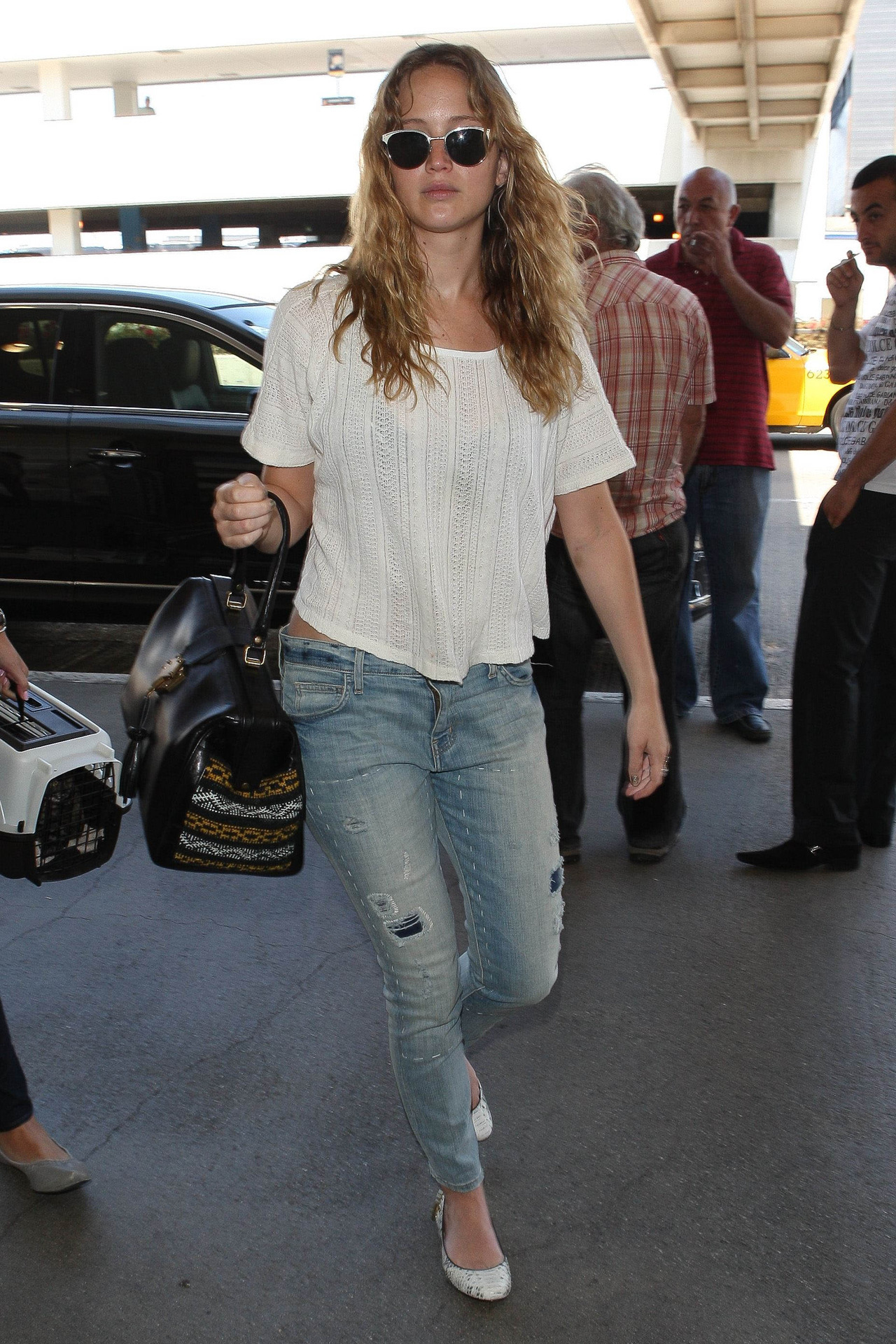 Jennifer Lawrence at LAX, August 22nd