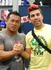 "Japanese bodybuilder Hidetada Yamagishi and NASA JPL's Bobak ""The Mohawk Guy"" Ferdowsi"