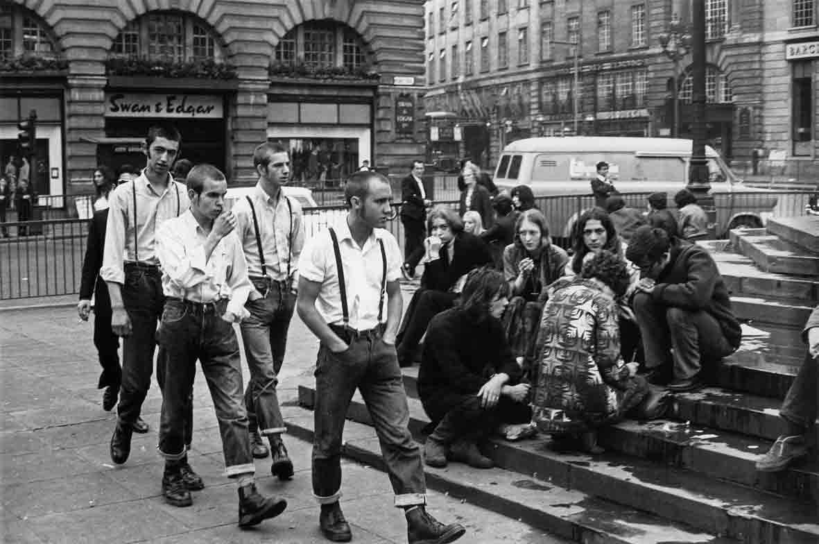 A clash of two worlds in London; skinheads and hippies. Circa 1969.