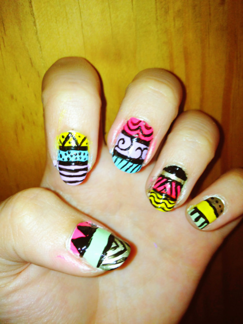 Tribal nails!  Yellow: China Glaze in Sunshine Pop  Green: OPI in Gargantuan Green Grape  Blue: Sephora by OPI in Natural Environ-mint  Pink: Forever 21 Love and Beauty in Neon Pink  Metallic: Sally Hansen in Canary Diamond Chrome  Lavender: Sephora by OPI in It's Hippo to be Square  Black: nails inc. London in Black Taxi