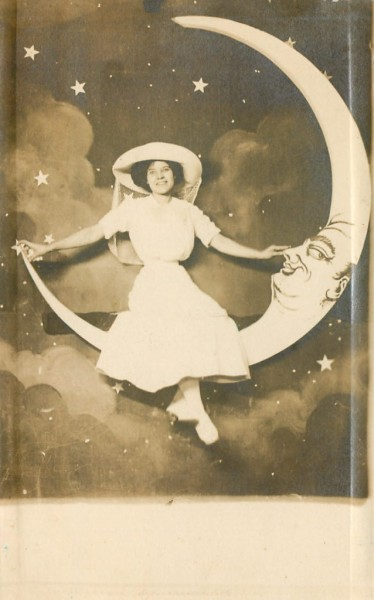Smiling Beauty on a Paper Moon c.1912