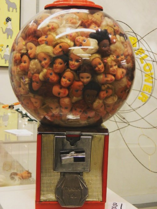 Creepy Gumball Machine Full of Barbie Heads I don't remember this scene from Toy Story.