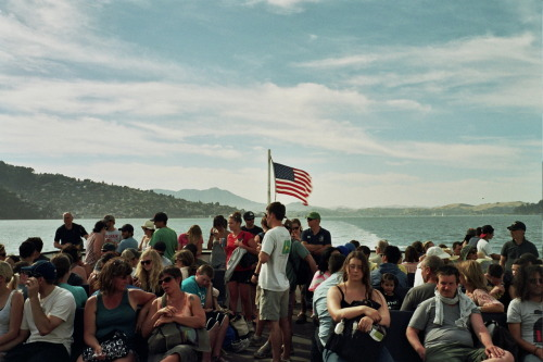 Wonderful, under the flag people. Ferry people. Angel Island to San Francisco. Sometime in June.