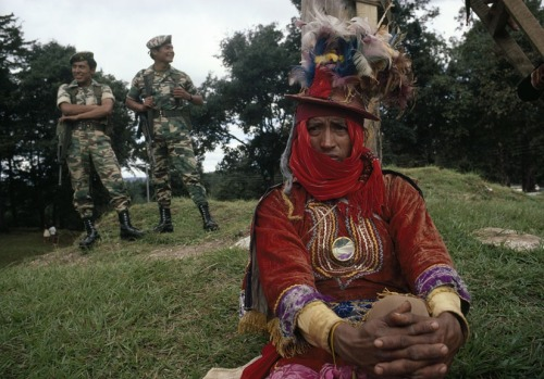 Soldiers watching Indian festival, Gumarcaaj, Quiché, 1980s. From Guatemala's Lost Photographs by Jean-Marie Simon.