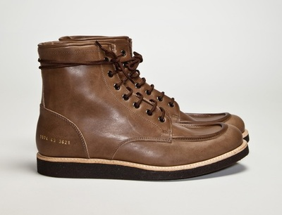 Common Projects Work Boot Brown If you're looking to invest in a pair of finely made boots, look no further than the new work boot from Common Projects, made of 100% premium leather. It has wool lining and a wedge rubber sole on a stormwelt construction with metal eyelets and tone on tone laces. The shoe was made in Italy and is available for $550.