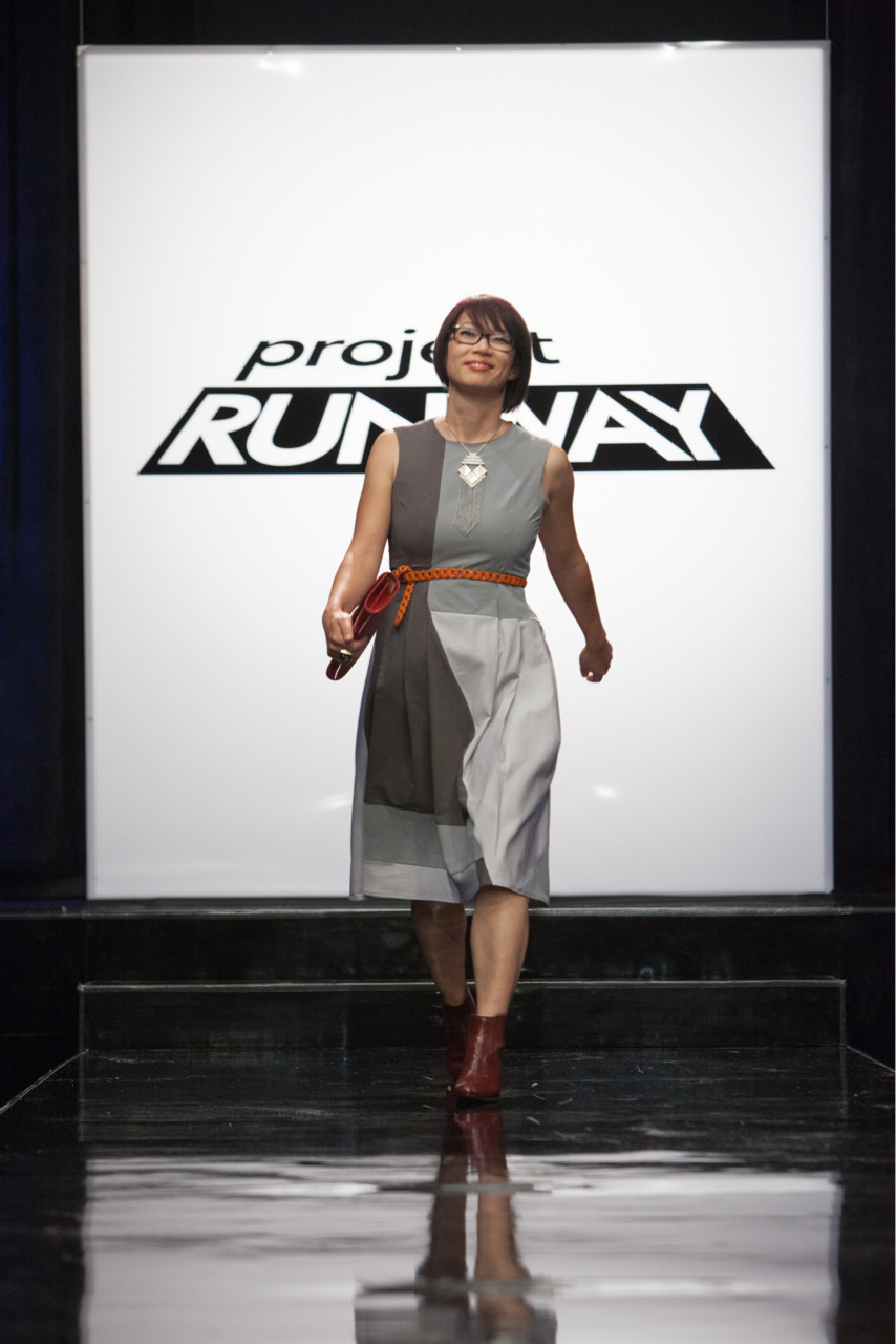 "Who doesn't love a good fashion makeover?  This week's episode of Project Runway tasked the designers with making over a group of real women, whose friends brought them there as an act of love.  Each designer was paired with a makeover client to create a new look for them involving an outfit, a new hairstyle and a make-up transformation.  The goal: To make each woman look and feel her best.     This was one of the best challenges because the diversity of clients in all shapes and sizes, describing their own personal challenges with fashion, was very relatable.  Sonjia's client Amanda doesn't like to shop or know how to buy things – so she just doesn't shop.  Fabio's client, Ko-Rely, hates dresses and she only wears them, ""when I'm forced to.""  Ven's client, Terri, never wants to leave her jeans.  The beauty of this challenge was the emotions involved as personal relationships developed between the designers and their clients.  We really enjoyed the playful interaction between Gunnar and his client—showing a softer side to him.   The transformation process is not without it's own sense of drama.  A theme that was played up in this episode was the need for sensitivity to different sizes of ""real women"" versus models.  Some of the designers were concerned that the challenge was not fair because of the client they were assigned to.  Ven seemed to have a hard time grasping the needs of Terri.  His constant references to her size set the other designers off, while he remained defensive about the difficulty he was having in creating a look for her.  Even Terri felt offended, and at times was teary-eyed.     Elena's client Jenna wore a lot of color before, so her design was based around a more neutral color palette.  Fabio designed Ko-Rely into a dress that she'd want to wear.  Gunnar put his client Kim in a slimming black silk chiffon LBD, after her friend told him Kim's fashion sense never matched her larger than life personality.  By the time Kim went down the runway, she had a strut that was unmatched.  Michael Kors noted, ""You could teach Giselle how to move.""   Accessories took a front row seat on the runway, right along with the new hairstyles and make-up that completed the makeovers.  It was hand-held fever as clutches completed the looks in various hues and degrees of ornamentation.  Nina called out the studded clutch that Dmitry's client Angela carried; appropriately paired with booties.  Manrepeller would have been proud because there was no shortage of ""arm parties"", as colored bangles were stacked high.    At judging time Nathan's look wasn't well received.  Heidi said that Liana looked ""cheap"" and like a ""hoochie mama"".  Nina dismissed it as being a complete disaster while Michael said Nathan's use of ""illusion creating"" fabric was best served on someone closer to Betty White's age.  For this, Nathan was sent home this week. This week's winner was Fabio, for his asymmetrical dress in different shades of gray, with various seams and unique proportions.  He paired it with medium heeled Chelsea boots and a graphic necklace.  Along with her really edgy haircut, Ko-Rely's outfit got a lot of attention from the judges.   The judges decided to keep Ven, despite his misgivings about working with his client and the less than tasteful look he created for her.  It makes us wonder, did they save him for the drama?  We will find out more next week!"