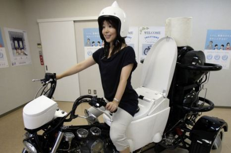 braiker:  Japan's new TOTO toilet bike — An eco-friendly three-wheel 250cc motorcycle – with a toilet for a seat – that runs on bio-fuel from the discharge of livestock or waste water. PS: TOILET BIKE!